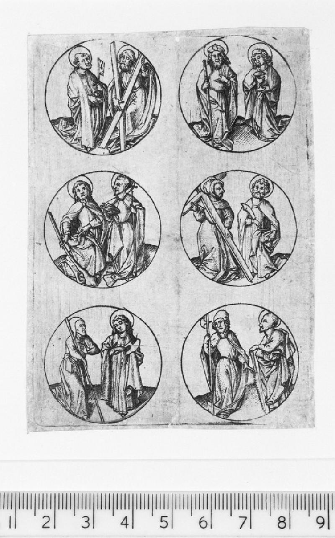 The twelve apostles standing in roundels