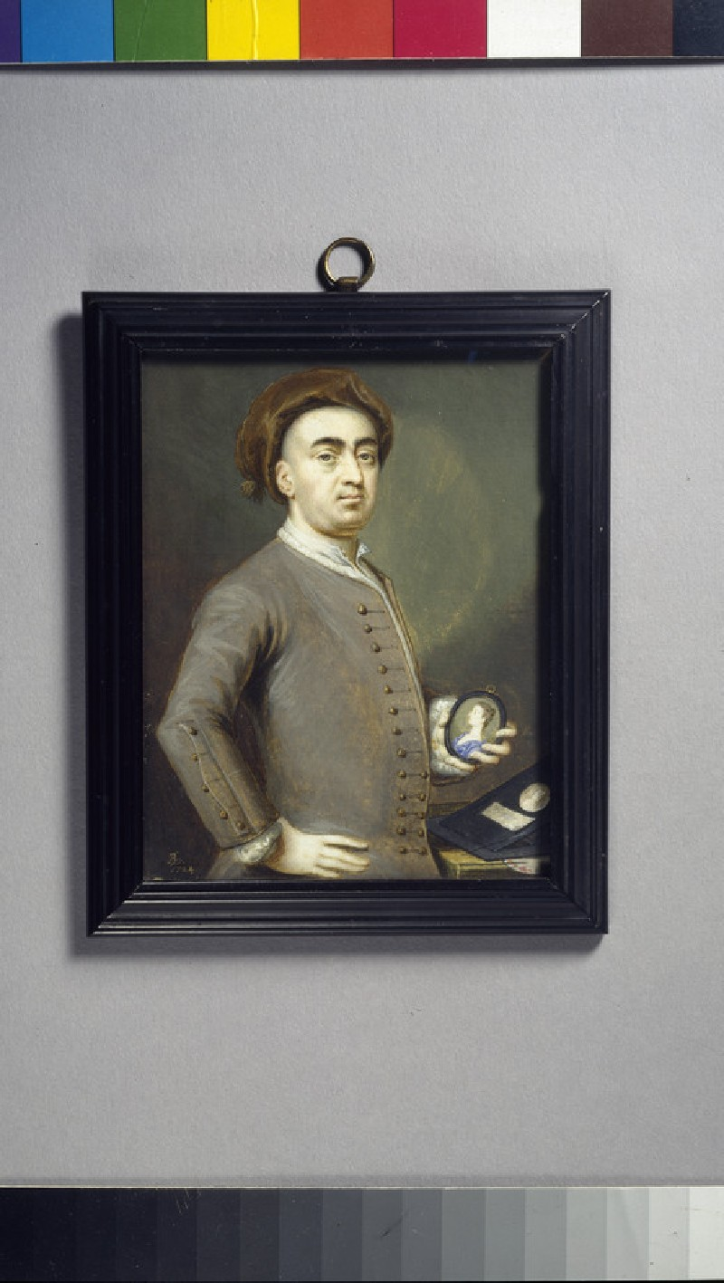 Self Portrait holding a miniature