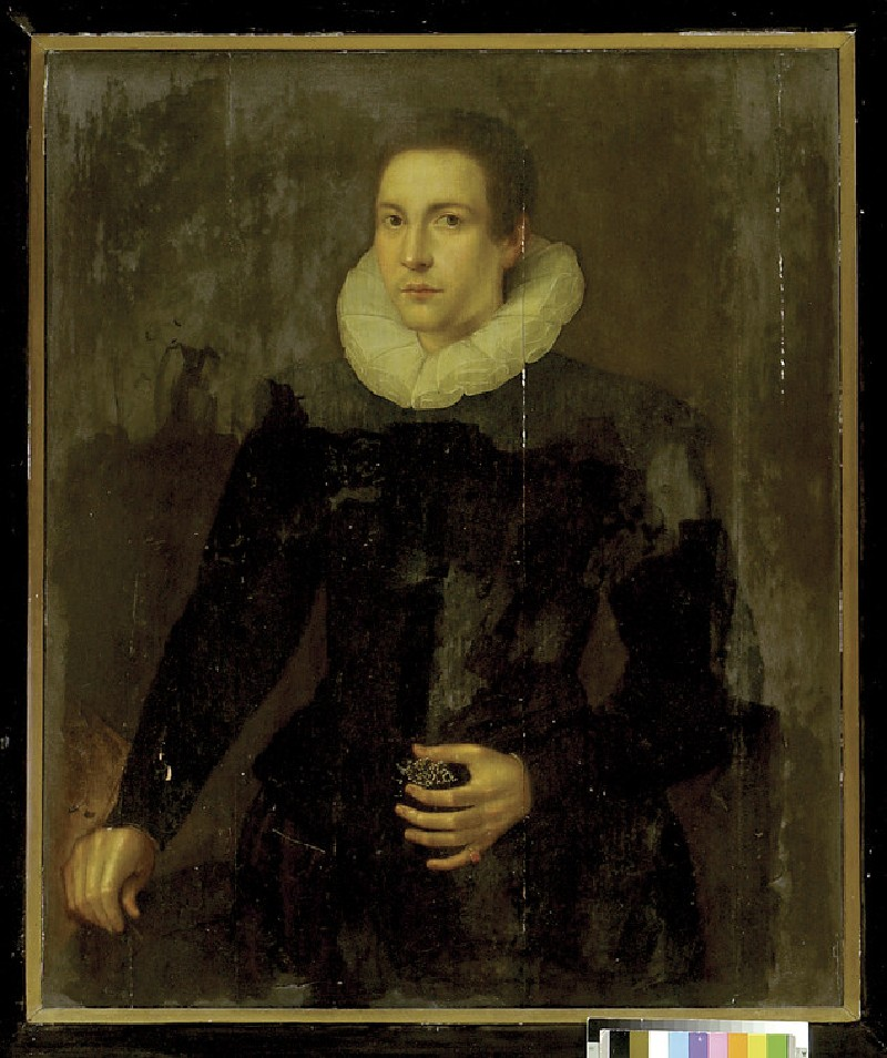 A young Man holding a jewel