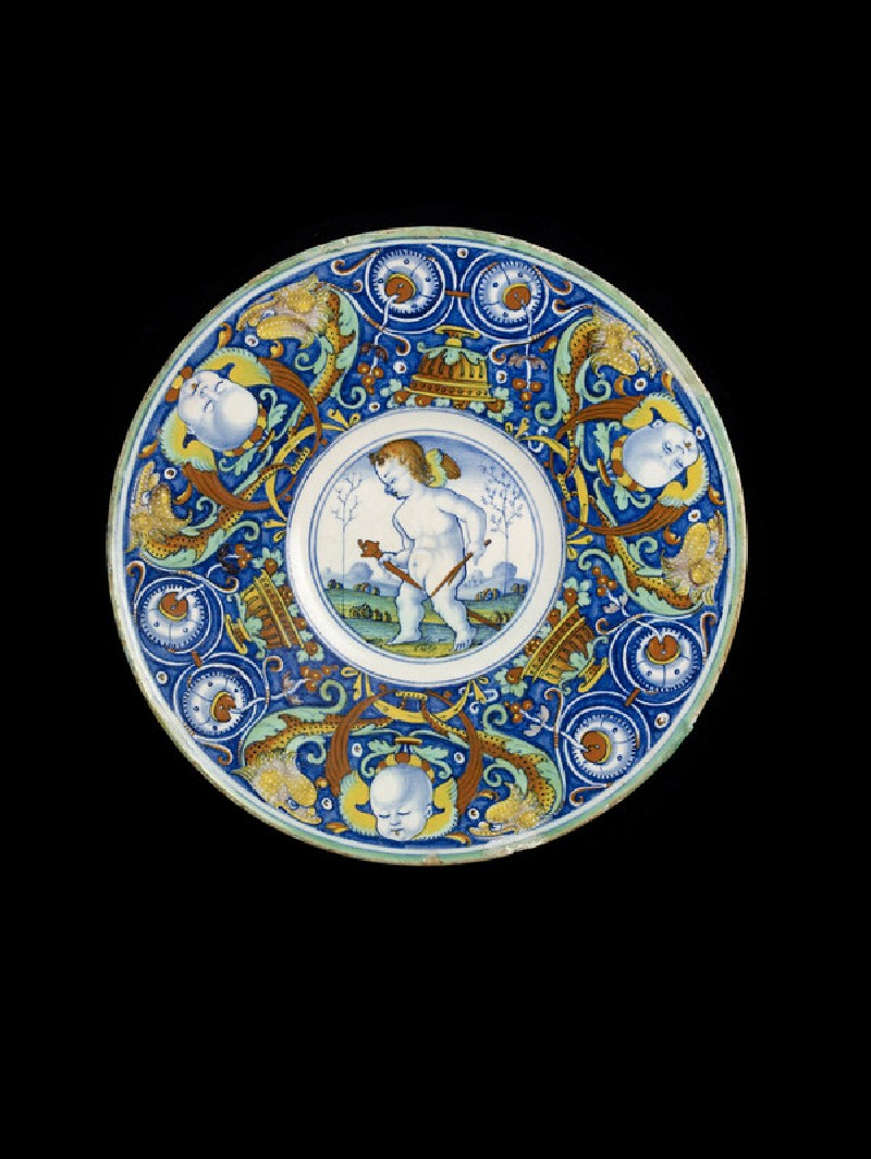 Plate with a winged boy on a hobby horse