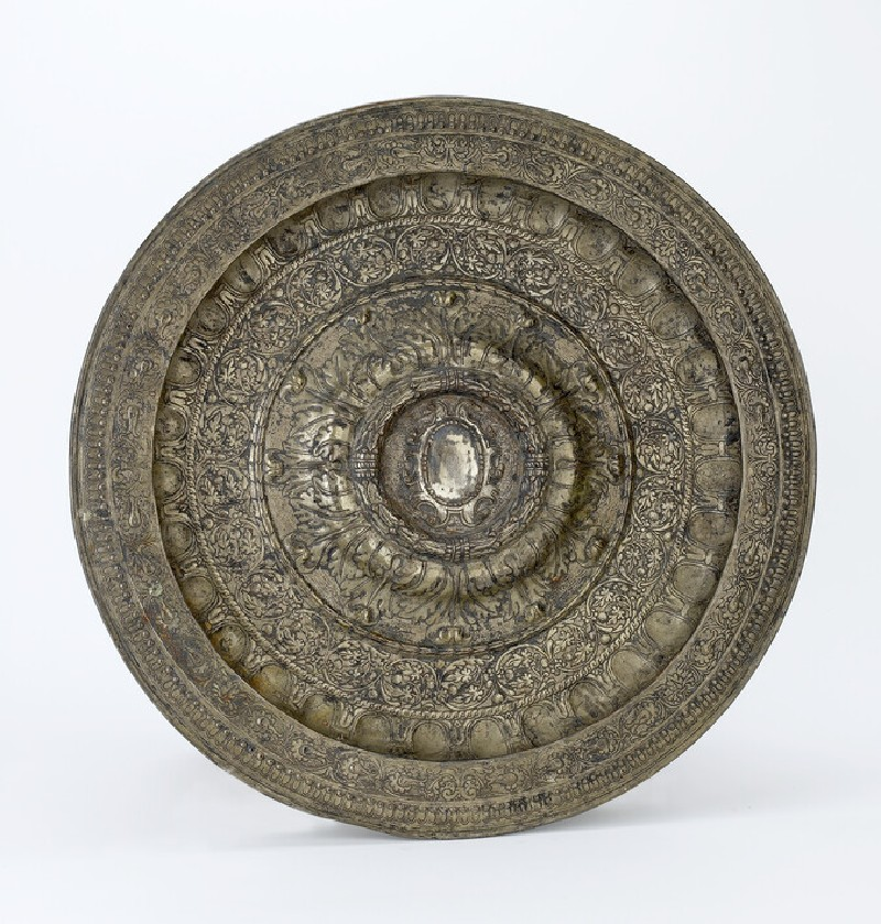 Salver with raised centre bearing a scroll-work shield for arms, surrounded by a raised wreathage border