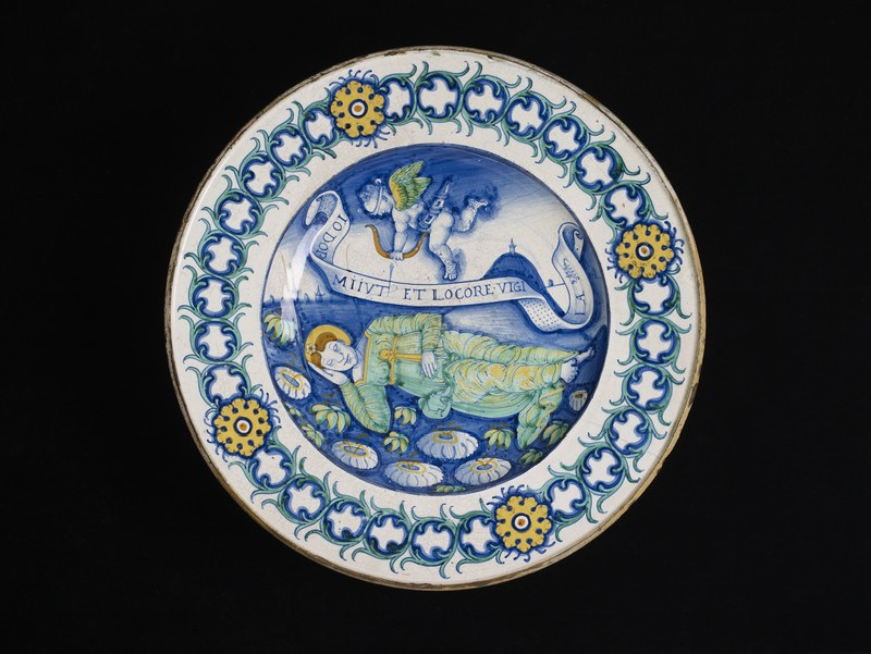 Plate, a woman dreaming and Cupid