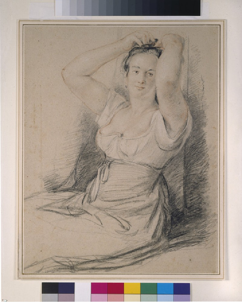 A Woman tiring her Hair