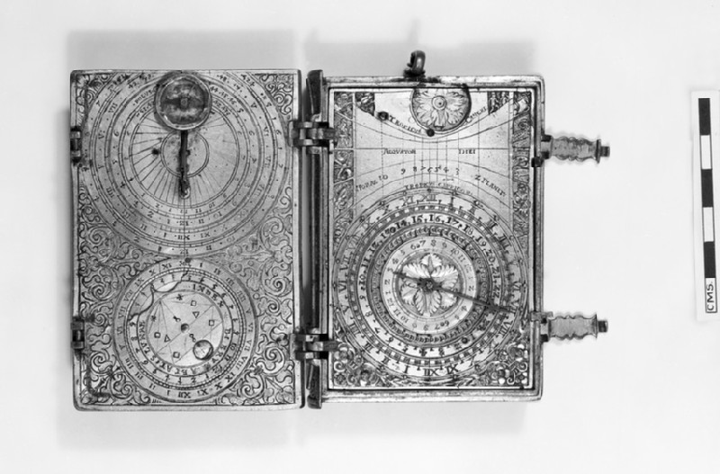 Gilt-brass cased clock-watch with alarm, sundials and lunar volvelle in the form of a book (WA1947.191.7)