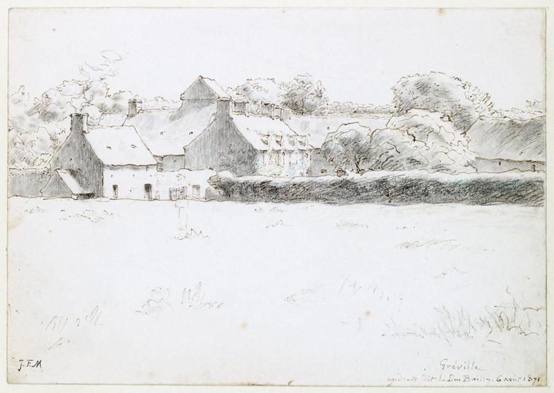 View of farm buildings across a field