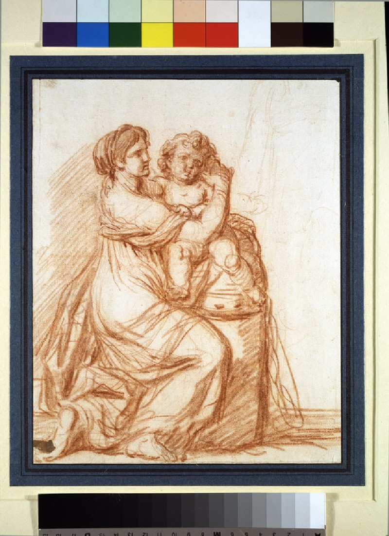 A kneeling woman holding a child