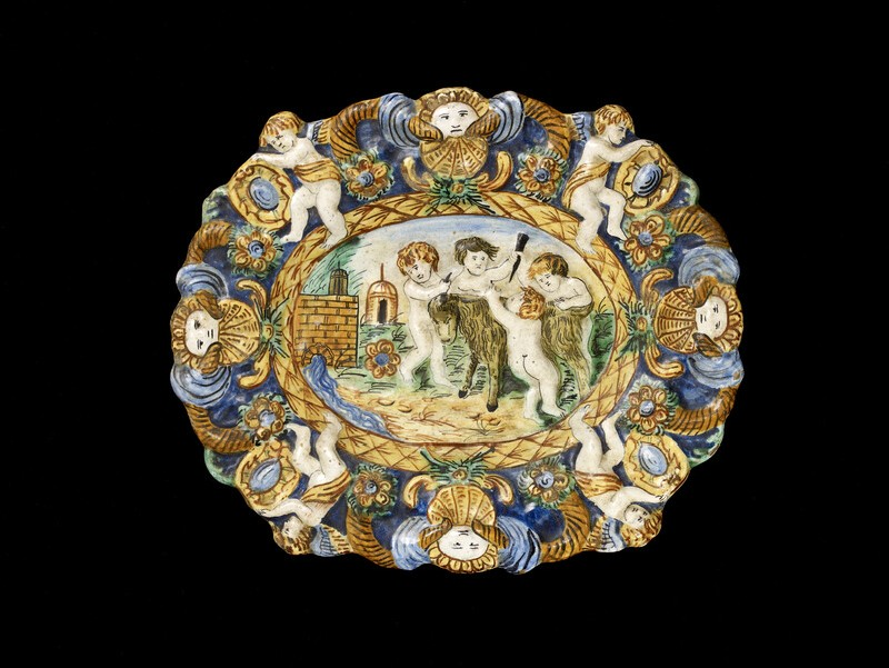 Dish with putti tormenting a goat