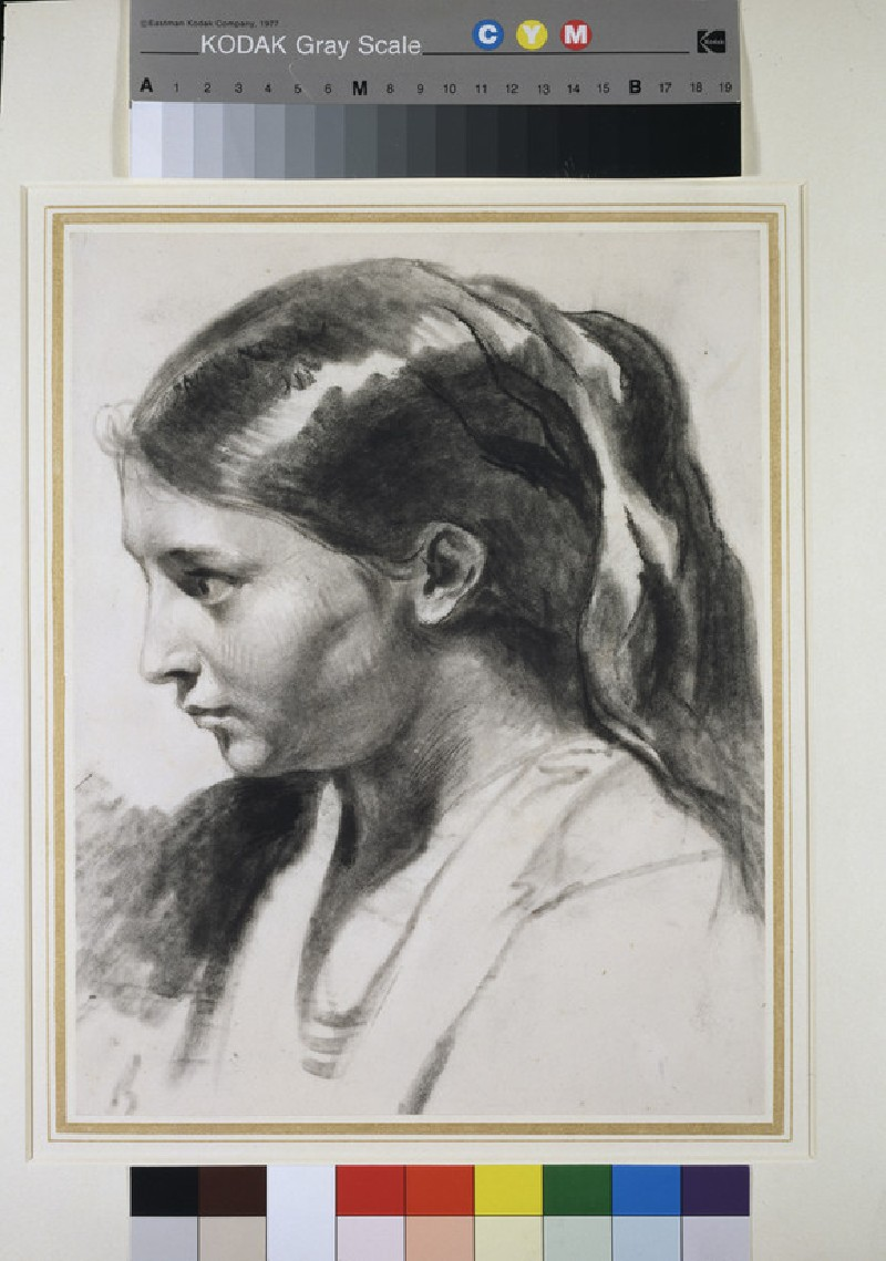 A girl's head in profile to left