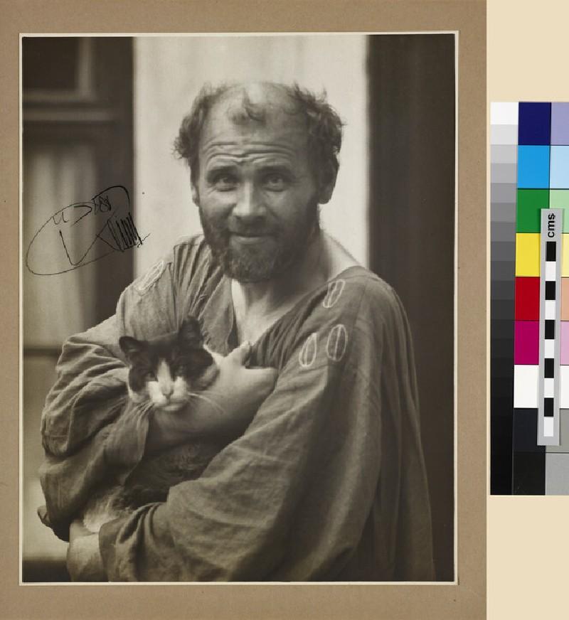Gustav Klimt holding a cat