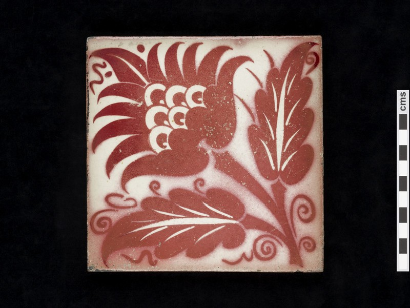 Tile with with peony style flower and leaves
