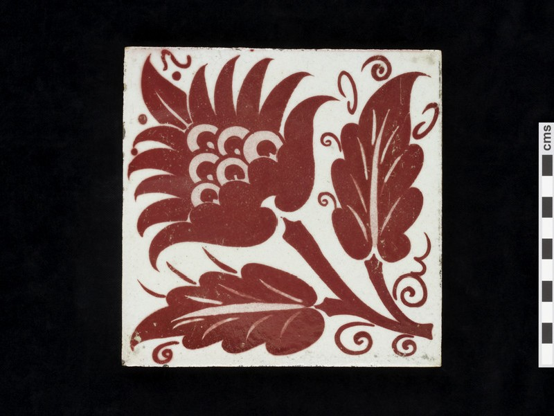 Tile with peony style flower and two leaves (WA1974.273.2)