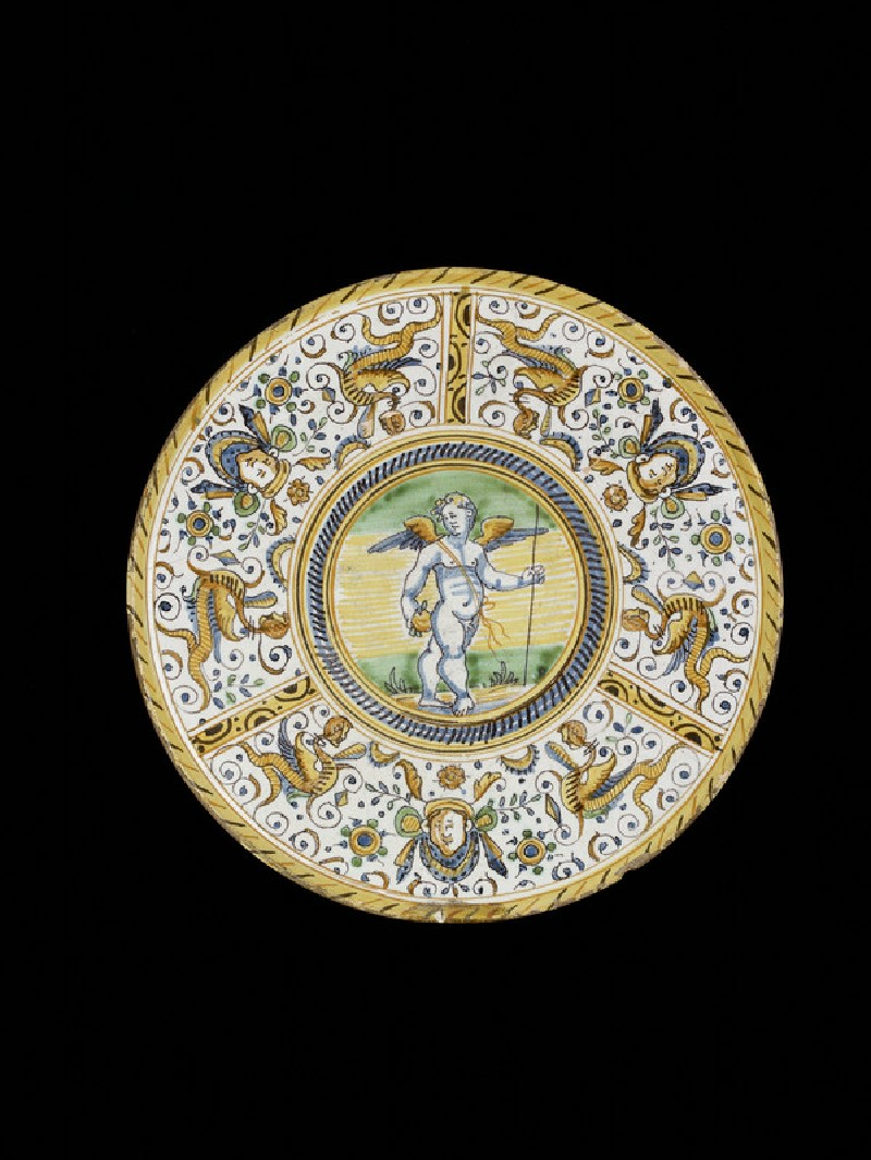 Dish on high foot, Cupid and grotesque decoration