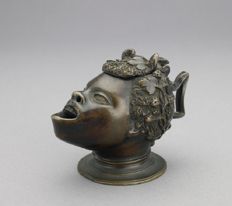 Oil lamp in the form of the head of a satyr with African features (WA2005.87)