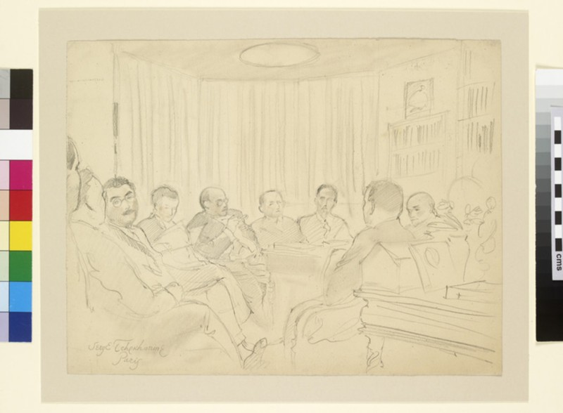 Nine men seated round a table