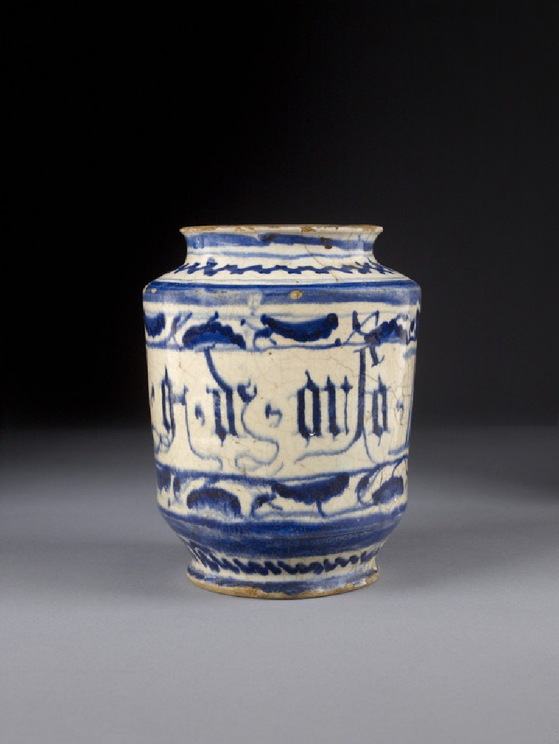 Albarello, or pharmacy jar, straight-sided, flanged at rim. Painted in blue with plant motifs and a scroll (WA2014.3)