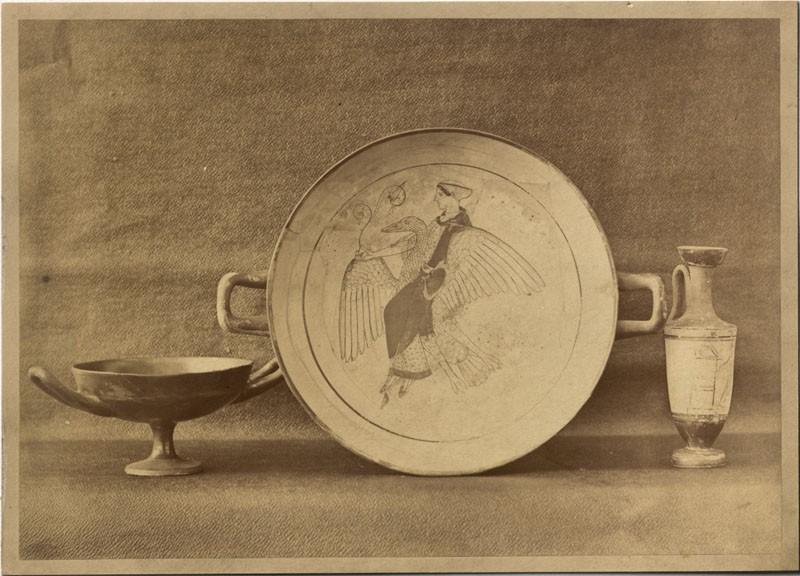 A Photograph of three Greek Ceramics, including a Patera showing Aphrodite riding a Swan