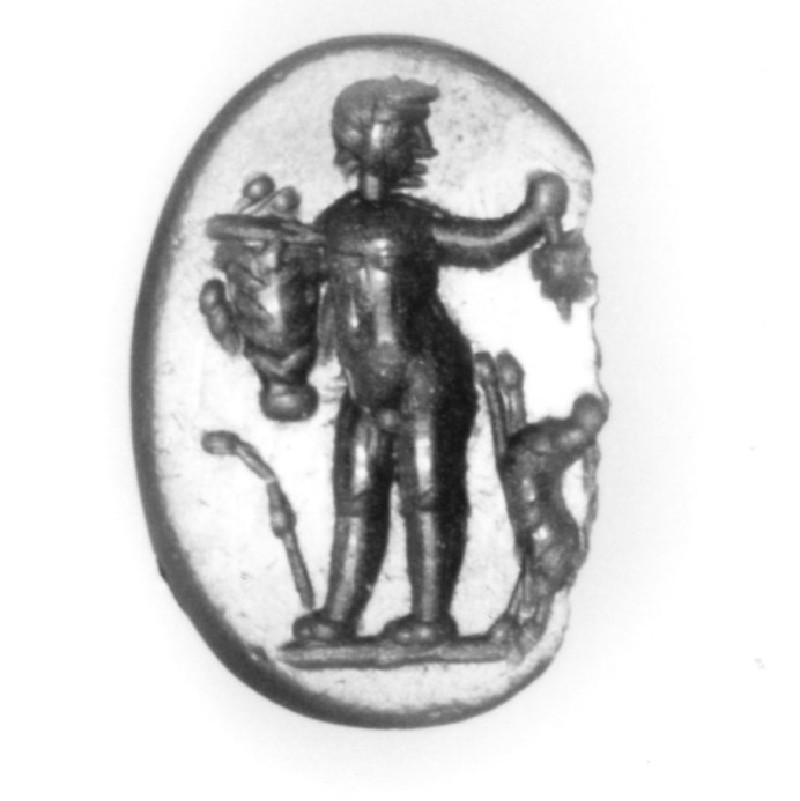 Intaglio gem, satyr acing left with basket and bunch of grapes