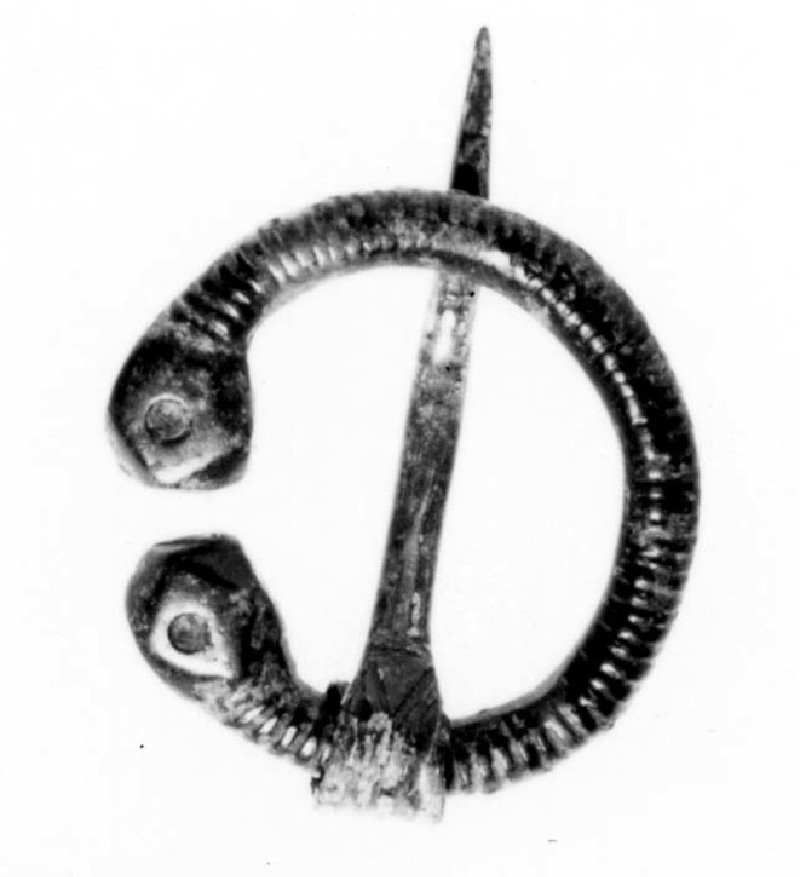 Penannular brooch with polyhedral terminals, each with a dot punched in the face (AN1961.55, record shot)