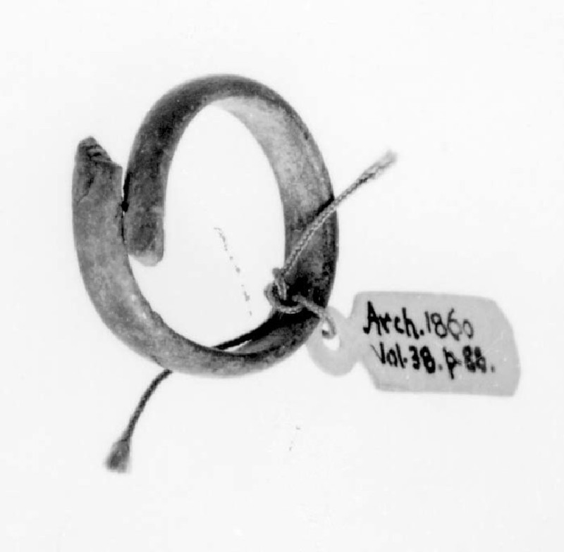 Ring of stout bronze wire with overlapping ends, slightly flattened in section
