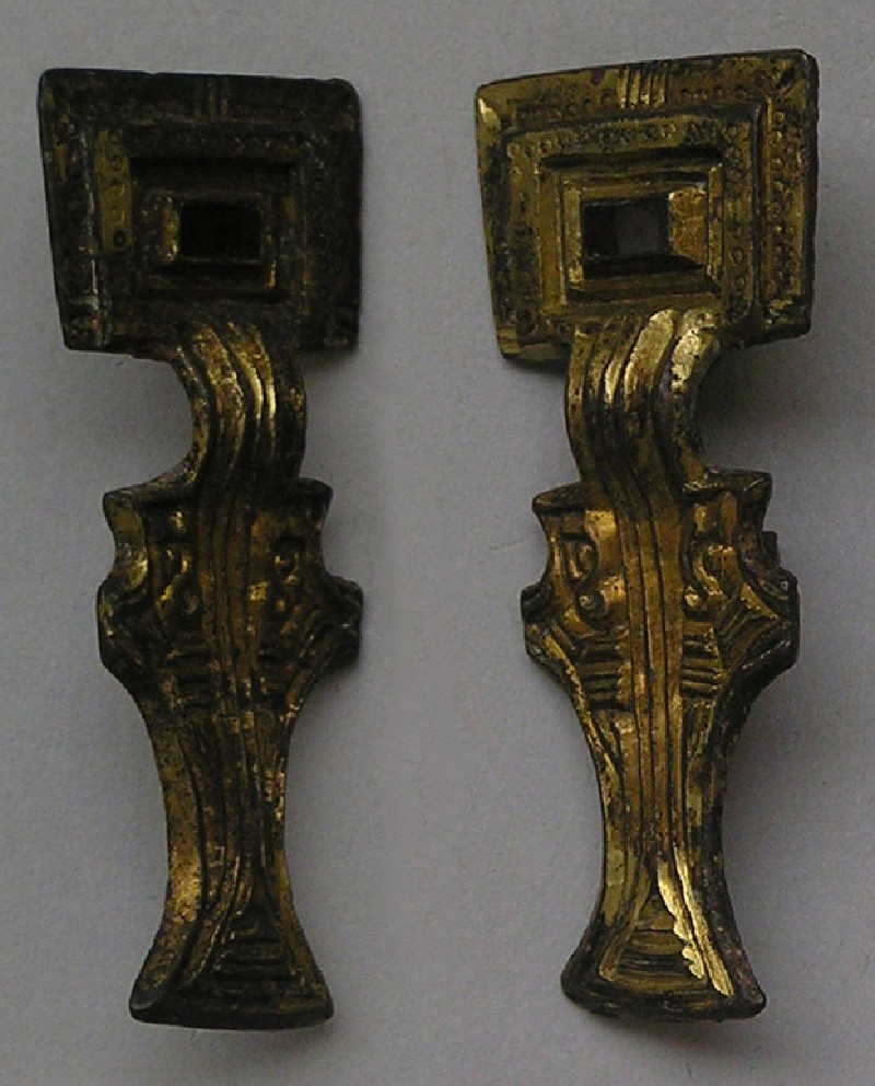 One of a pair of square-headed brooches, gilt copper alloy and garnet