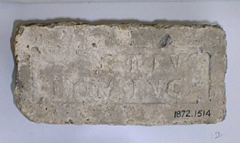 Brick stamped with Latin script, figure of palm-branch on each side of inscription