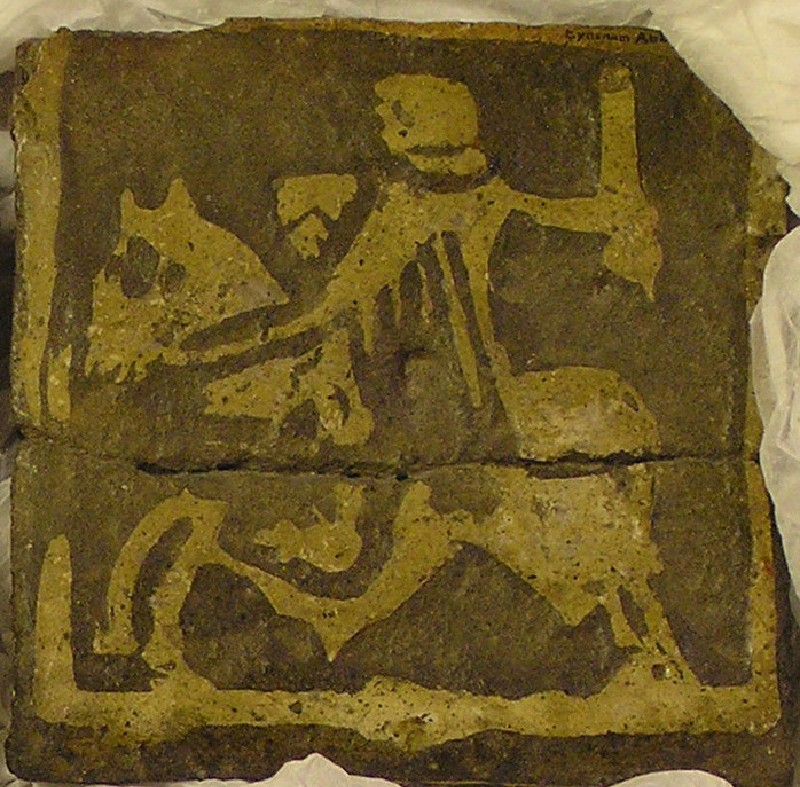 Encaustic tile with knight on horseback motif
