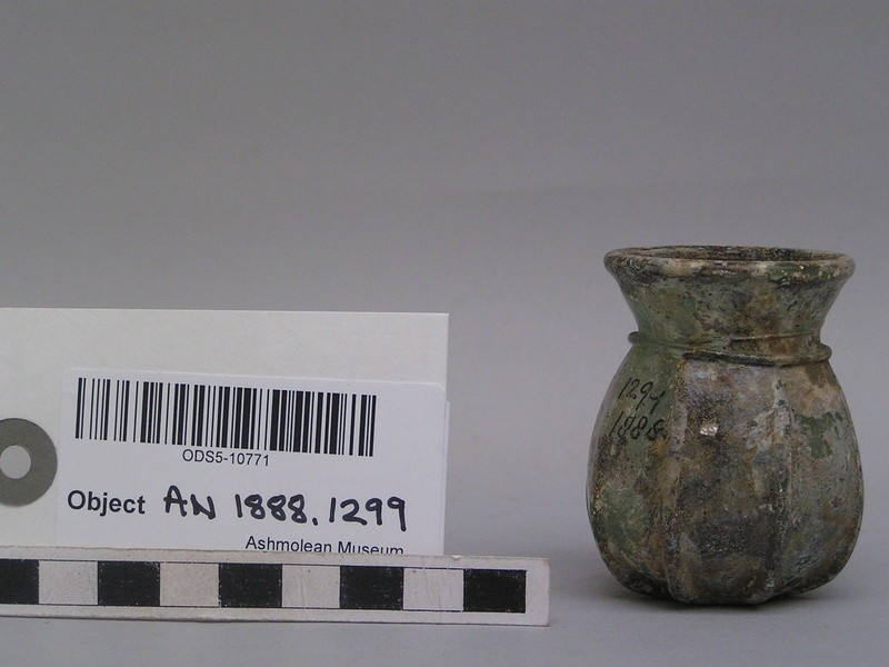 Glass pot with relief decoration