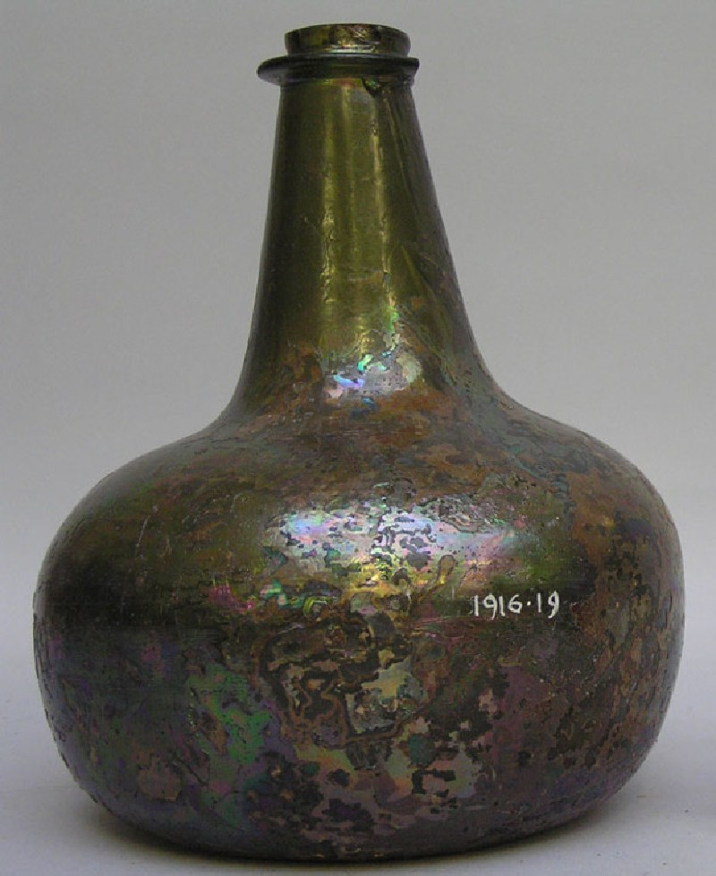 Green glass wine bottle, with stamp of Anne Morrell, Crown, and 1685