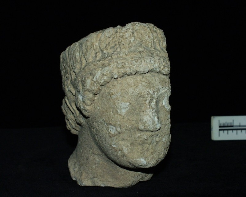 Limestone male head with leaf-wreath, Cypriot or local (AN1937.437, record shot)