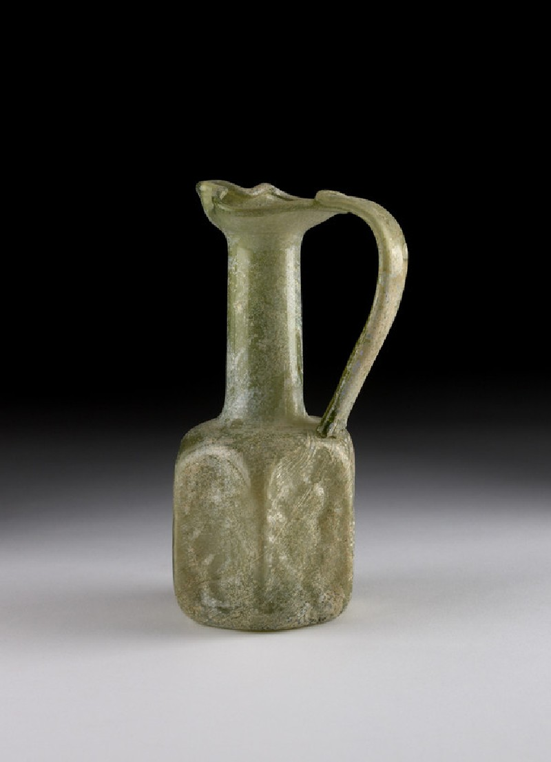 Glass juglet with hexagonal body, each side with different motif