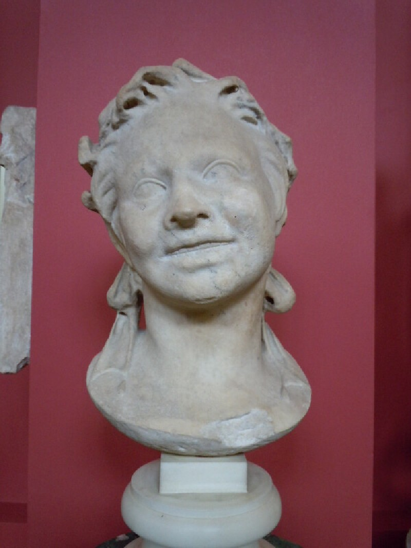 Statue head of an infant satyr