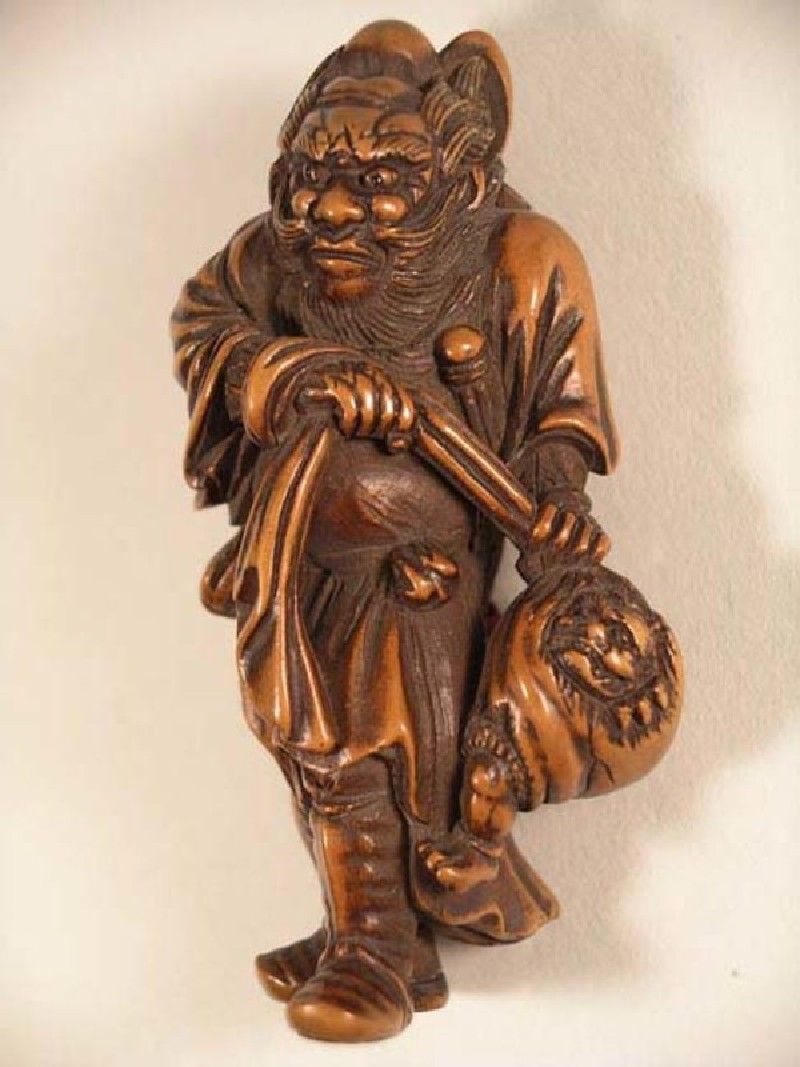 Netsuke in the form of Shōki holding a captured demon in a bag (EA1956.1730, record shot)