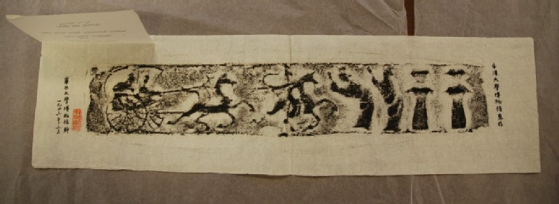 Rubbing of tomb brick decorated with charriots and officials (EAX.556, record shot)