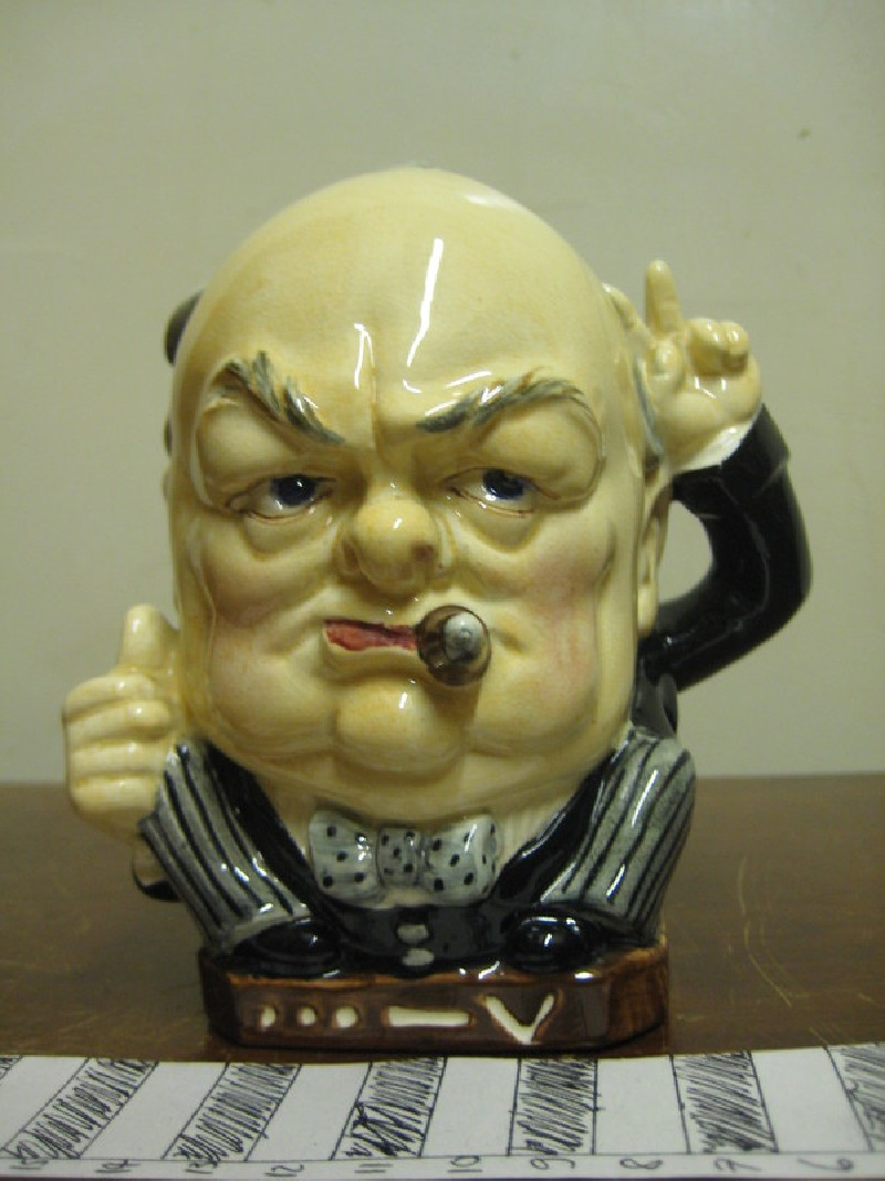 Winston Churchill mug with left arm and hand in victory sign as handle, sketchy body as base