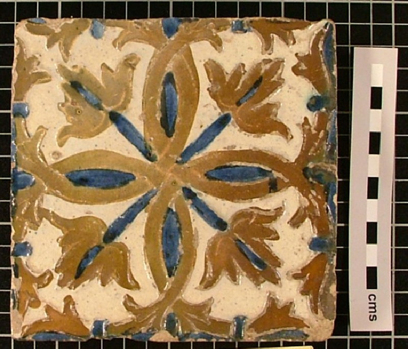 Tile with rosette design with four interlacing lobes