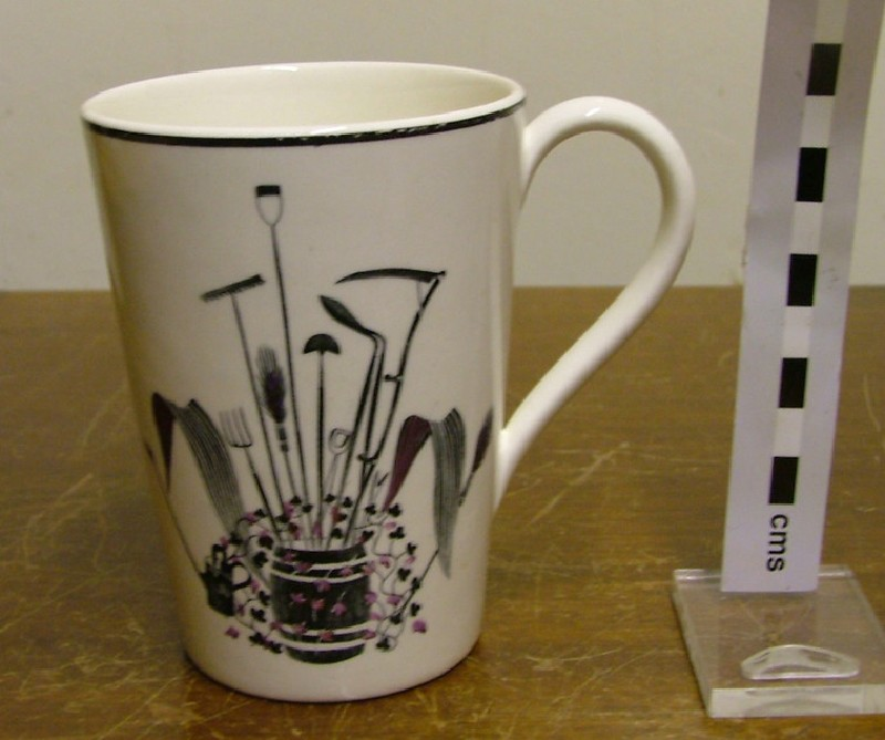 Mug, with black print,  'Garden Implements'