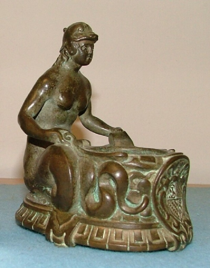 Inkstand in the form of a mermaid holding a receptacle for an inkwell (WA1888.CDEF.B1081, record shot)