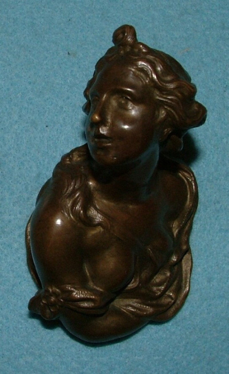 One of a pair of door handles in the form of busts of lovers in conversation