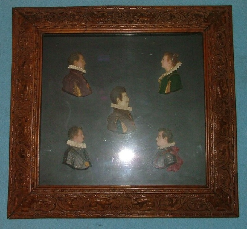 Five profile portrait busts in a carved frame (WA1899.CDEF.S30, record shot)