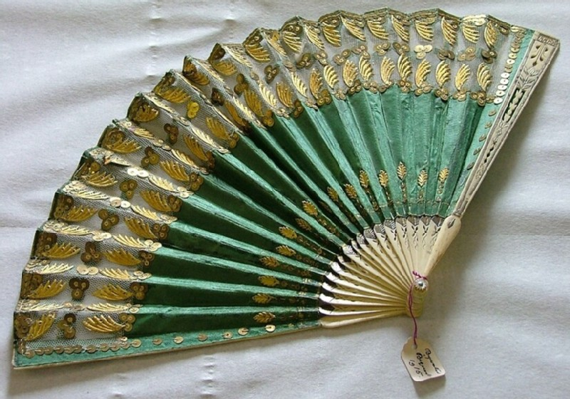 Folding fan of green silk with gilded guard sticks