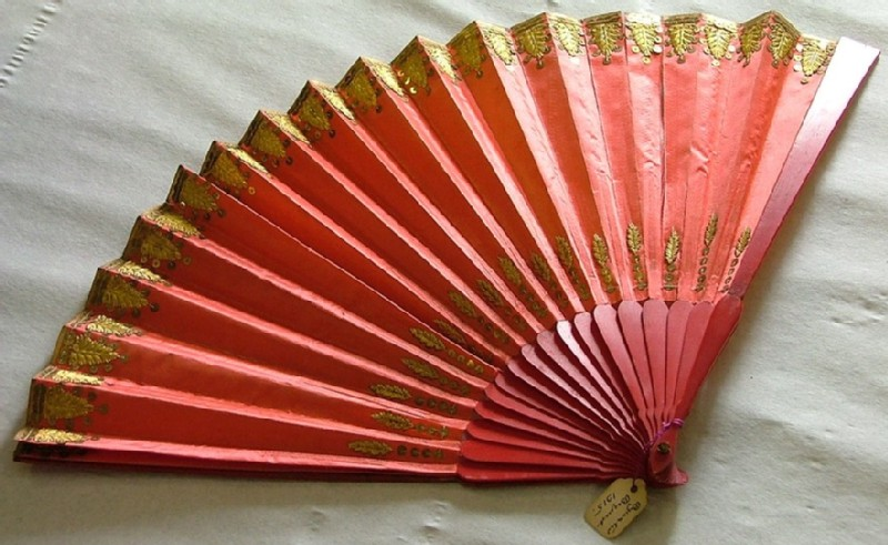 Folding fan of pink silk with painted sticks and gold decoration