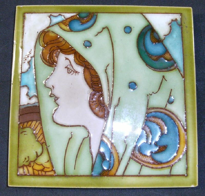 Tile with side portrait of girl with shawl over her head
