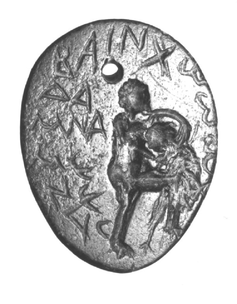 Magical intaglio gem, Herakles fights the Nemean lion, inscribed