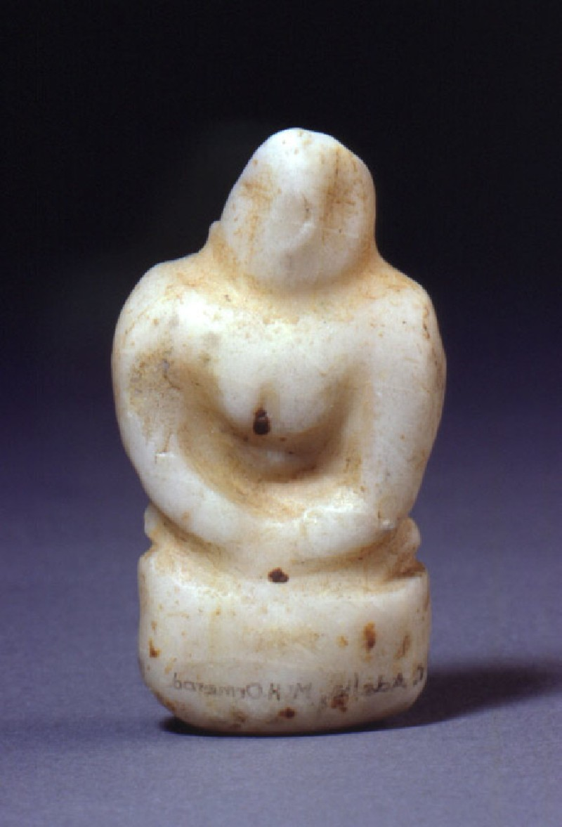 Seated female figurine with hands clasped below breast (AN1911.289, record shot)