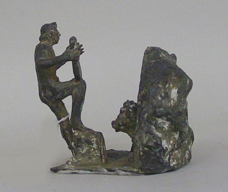 Figurine of Orpheus charming Cerberus