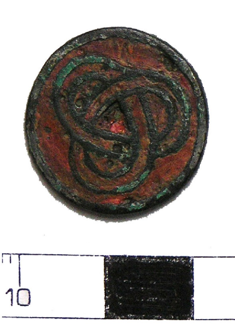 Disc or stud with decoration of interlocking loops