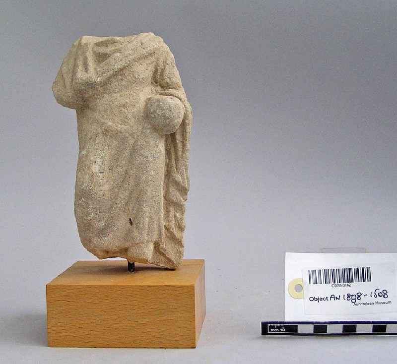 Votary with Greek inscription on right side