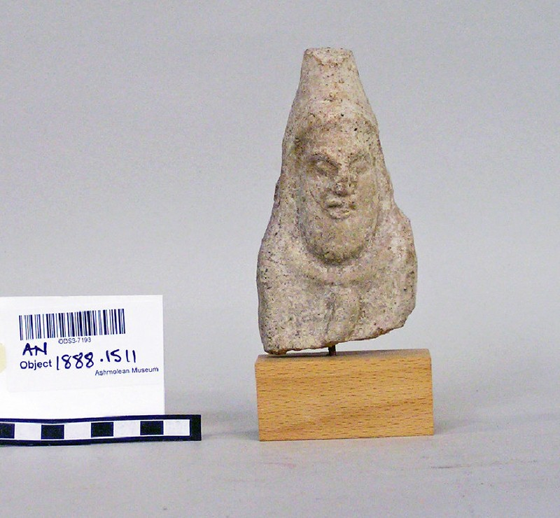 Male votary bearded head with conical headdress and shoulder, terracotta figure fragement