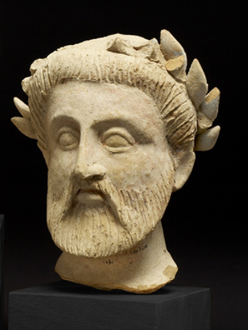 Head of bearded male, fragment of a terracotta funerary figure (AN.1890.696.x)