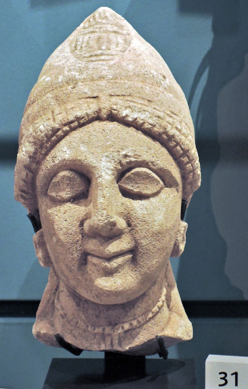 Limestone head of female votary, votive statuette (AN1896-1908.C.275, AN.1896-1908.C.275, record shot)